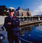 A Commisionnaire along Victoria's waterfront promenade on Vancouver Island, British Columbia, Canada
