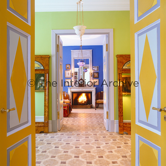 In an apartment in St Petersburg a series of double doors and ante-rooms leads to a living room painted bright ultramarine blue