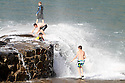 15/08/12 ..A group of young lads play in crashing waves on the old quay wall at Hartland, North Devon...All Rights Reserved - F Stop Press.  www.fstoppress.com. Tel: +44 (0)1335 300098.Copyrighted Image. Fees charged will reflect previously agreed terms or space rates for individual publications, states or country.