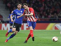 Copenhague's player Andrija Pavlovic; Atletico Madrid's Uruguayan defender Diego Godin