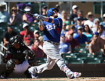 Los Angeles Dodgers&rsquo; Yamani Grandal bats against the Arizona Diamondbacks in a spring training game in Scottsdale, Ariz., on Friday, March 18, 2016. <br />Photo by Cathleen Allison
