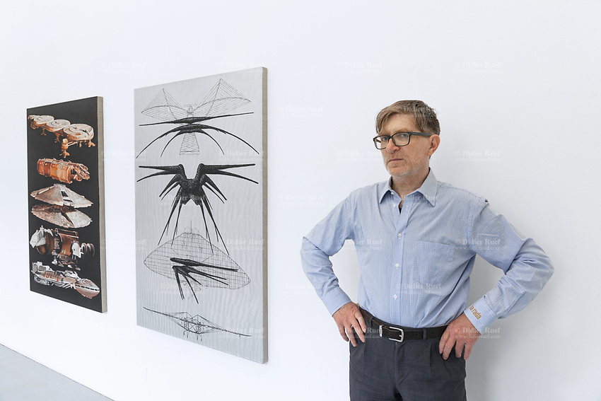 "Switzerland. Canton Ticino. Locarno. Riccardo Lisi is the director of the art gallery "" la rada"" (Spazio per l'arte contemporanea). ""Battlestar Galactica Spaceships"" (2019) (L) and ""Shadow Ship"" (2019) (C) are paintings by swiss artist Mathis Gasser. 1.05.2020 © 2020 Didier Ruef"