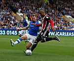 Leon Clarke of Sheffield Utd and Tom Lees of Sheffield Wednesday during the Championship match at the Hillsborough Stadium, Sheffield. Picture date 24th September 2017. Picture credit should read: Simon Bellis/Sportimage