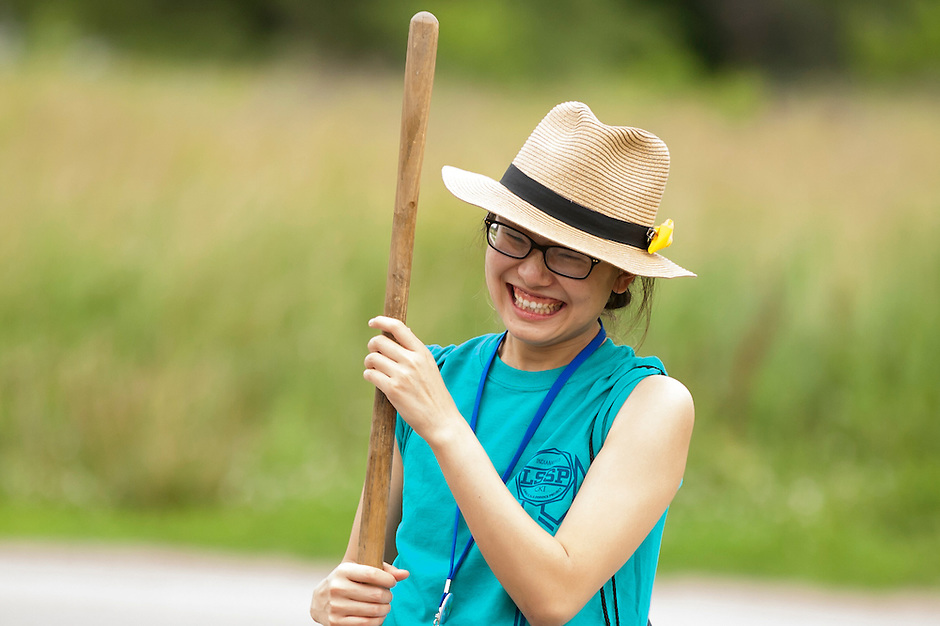"""Amber Huang shares a laugh with fellow members as she works to clean up curbs during """"Circle the City with Service,"""" the Kiwanis Circle K International's 2015 Large Scale Service Project, on Wednesday, June 24, 2015, in Indianapolis. (Photo by James Brosher)"""