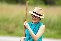 "Amber Huang shares a laugh with fellow members as she works to clean up curbs during ""Circle the City with Service,"" the Kiwanis Circle K International's 2015 Large Scale Service Project, on Wednesday, June 24, 2015, in Indianapolis. (Photo by James Brosher)"