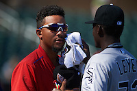 Glendale Desert Dogs shortstop J.P. Crawford (4) gets assistance from Robinson Leyer (73) during a pre-game standoff before an Arizona Fall League game against the Surprise Saguaros on October 23, 2015 at Salt River Fields at Talking Stick in Scottsdale, Arizona.  Glendale defeated Surprise 9-6.  (Mike Janes/Four Seam Images)