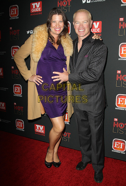 HOLLYWOOD, CA - NOVEMBER 4: Neal McDonough, Ruve Robertson at TV Guide Magazine's Hot List Party at The Emerson Theatre on November 4th, 2013 in Hollywood, California, USA.<br /> CAP/ADM/KB<br /> &copy;Kevan Brooks/AdMedia/Capital Pictures