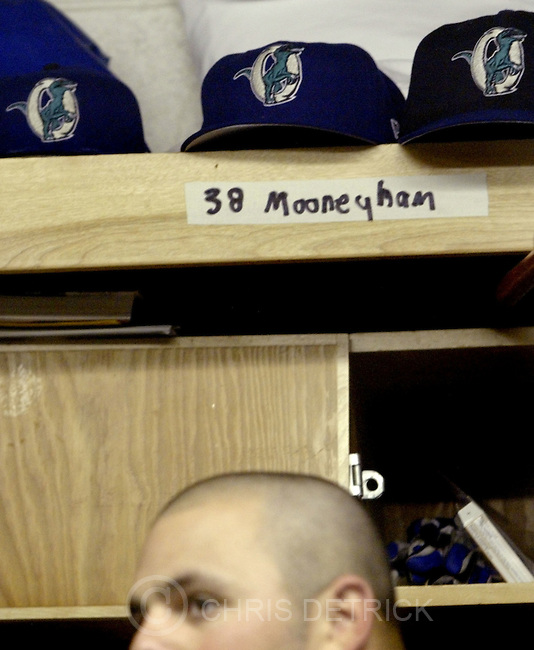 Ogden,Utah--7/8/2005--.Ogden Raptor Jason Mooneyham gets ready in the locker room before the game against the Casper Rockies...Photo By: Chris Detrick /Salt Lake Tribune.File Number: 816G8726
