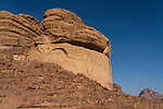Eroded sandstone walls in the Wadi Rum Protected Area, a UNESCO World Heritage Site.  Hashemite Kingdom of Jordan.