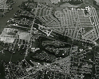 1964 October 07..Assisted Housing..Diggs Town (6-6).Oakleaf Forest.Campostella Heights (lower left)...Aerial view looking East..PHOTO CRAFTSMEN INC..NEG#.NRHA#