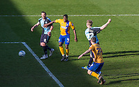 Jason McCarthy of Wycombe Wanderers fires a shot at goal during the Sky Bet League 2 match between Wycombe Wanderers and Mansfield Town at Adams Park, High Wycombe, England on 25 March 2016. Photo by Andy Rowland.