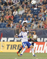 Montreal Impact midfielder Felipe Martins (7) and New England Revolution midfielder Clyde Simms (19) battle for the ball. In a Major League Soccer (MLS) match, Montreal Impact defeated the New England Revolution, 1-0, at Gillette Stadium on August 12, 2012.
