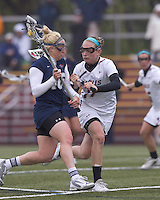 University of New Hampshire midfielder Rachael Nock (16) on the attack as Boston College midfielder Mikaela Rix (17) defends. Boston College defeated University of New Hampshire, 11-6, at Newton Campus Field, May 1, 2012.