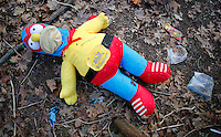 NWA Democrat-Gazette/DAVID GOTTSCHALK - 1/30/15 - A large stuffed doll outside a tent in the woods south of Martin Luther King Jr. Boulevard in Fayetteville Friday January 30, 2015 in the predawn hours. Areas with a homeless population were visited during the  Northwest Arkansas' biennial, 24-hour homeless census.