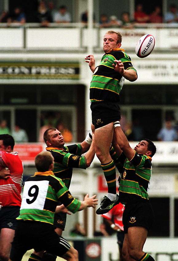 Photo Richard Lane. .Northampton v Bristol. 29/8/98. Tim Rodber wins a line out with the help of Phillips and Lam.