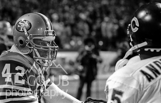 San Francisco 49ers vs Chicago Bears at Candlestick Park Monday, December 14, 1987..49ers Beat Bears 41-0.San Francisco 49ers Defensive Back Ronnie Lott (42) Greets Chicago Bears Defensive Running Back Neal Anderson (35)..