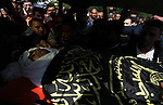 Mourners carry the body of Palestinian, Mahmoud Hathat during his funeral in Gaza City, on November 13, 2019. Photo by Mahmoud Ajjour