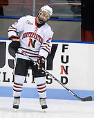 Drew Muench (NU - 21) - The Northeastern University Huskies defeated the Bentley University Falcons 3-2 on Friday, October 16, 2009, at Matthews Arena in Boston, Massachusetts.