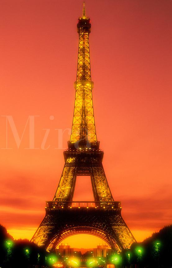 The Eiffel Tower illuminated at night .