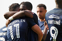 Dru Yearwood of Southend United congratulates Stephen McLaughlin after his goal during the Sky Bet League 1 match between Southend United and MK Dons at Roots Hall, Southend, England on 21 April 2018. Photo by Carlton Myrie.