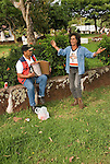 Chile, Easter Island: Two men singing, dancing, making music in Hanga Roa..Photo #: ch343-33083.Photo copyright Lee Foster www.fostertravel.com lee@fostertravel.com 510-549-2202