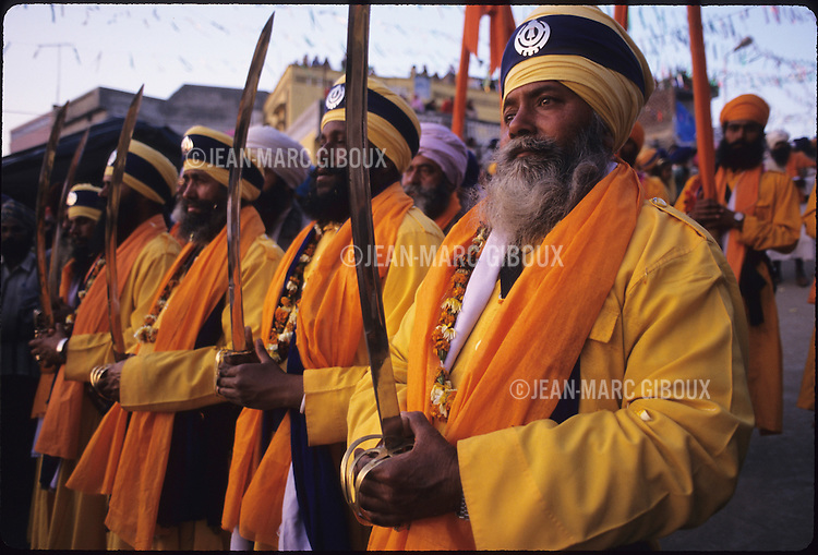 For the past 300 years the Nihangs, Holy warriors of Sikhism gather at the foothills of the Himalayas in Punjab to celebrate the Hola Mohalla,  the creation of the Sikh Army by Guru Gobind Singh to defend the Sikh homeland from the invading Mughal armies. Dressed in their traditional blue colors, they arrive barring their weapons  in Anandpur Sahib, demonstrating their prowess in martial arts and horse riding. Duels take place everywhere, while others prepare the 'Nectar', a cannabis-laced drink that they distribute freely. The 'Granth Sahib' , the holy book of Sikhism arrive in Anandpur Sahib's Keshgarh Sahib temple (Gurdwara) escorted by bodyguards. India, Punjab. (Photo by Jean-Marc Giboux)