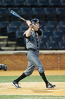 Justin Glass (16) of the Cincinnati Bearcats follows through on his swing against the Wake Forest Demon Deacons at Wake Forest Baseball Park on February 21, 2014 in Winston-Salem, North Carolina.  The Bearcats defeated the Demon Deacons 5-0.  (Brian Westerholt/Four Seam Images)