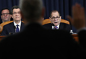 United States Representative Jerrold Nadler (Democrat of New York), Chairman, US House Judiciary Committee swears in constitutional scholars Noah Feldman of Harvard University, Pamela Karlan of Stanford University, Michael Gerhardt of the University of North Carolina, and Jonathan Turley of George Washington University prior to their testimony before the US House Judiciary Committee in the Longworth House Office Building on Capitol Hill December 4, 2019 in Washington, DC. This is the first hearing held by the House Judiciary Committee in the impeachment inquiry against U.S. President Donald Trump, whom House Democrats say held back military aid for Ukraine while demanding it investigate his political rivals. The Judiciary Committee will decide whether to draft official articles of impeachment against President Trump to be voted on by the full House of Representatives. Also pictured is majority counsel Norm Eisen (L). <br /> Credit: Drew Angerer / Pool via CNP