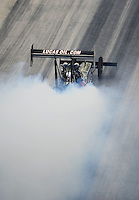 Sept. 17, 2010; Concord, NC, USA; NHRA top fuel dragster driver Morgan Lucas does a burnout during qualifying for the O'Reilly Auto Parts NHRA Nationals at zMax Dragway. Mandatory Credit: Mark J. Rebilas/