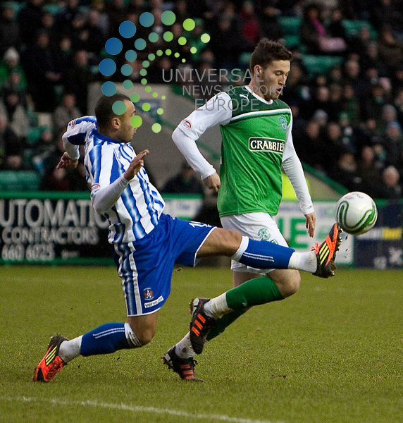 Hibernian v Kilmarnock, .William Hill Scottish Cup Fifth Round Tie..Ben Gordon beats Roy O'Donovan to the ball during the William Hill Scottish Cup Fifth Round Tie between Hibernian v Kilmarnock at Easter Road Stadium on Saturday 4th February 2012...Picture: Alan Rennie/Universal News and Sport (Scotland).