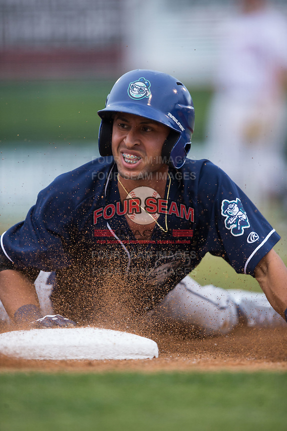Carlos Herrera (4) of the Asheville Tourists slides head first into third base with a triple against the Kannapolis Intimidators at Intimidators Stadium on May 28, 2016 in Kannapolis, North Carolina.  The Intimidators defeated the Tourists 5-4 in 10 innings.  (Brian Westerholt/Four Seam Images)