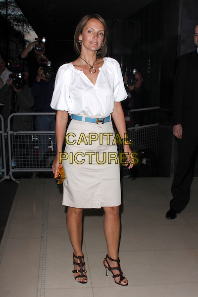 SAFFRON ALDRIDGE.'An Evening At Sanderson' at The Sanderson Hotel, London, England. .April 27th 2010 .full length top blouse skirt blue belt brown beige strappy sandals white .CAP/AH.©Adam Houghton/Capital Pictures.