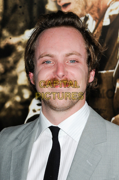 "TOM BUDGE.The Los Angeles premiere of HBO's new miniseries event ""The Pacific"" at Grauman's Chinese Theatre in Hollywood, California.  .February 24th, 2010.headshot portrait moustache mustache grey gray tie black white facial hair .CAP/ROT.©Lee Roth/Capital Pictures"