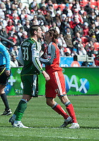26 March 2011: Portland Timbers forward Kenny Cooper #33 and Toronto FC forward Alan Gordon #21 in action during an MLS game between the Portland Timbers and the Toronto FC at BMO Field in Toronto, Ontario Canada..Toronto FC won 2-0....