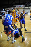 Brad Bowman is helped up by Sains teammates during the national basketball league match between Wellington Saints and Taranaki Mountainairs at TSB Bank Arena, Wellington, New Zealand on Friday, 17 June 2014. Photo: Dave Lintott / lintottphoto.co.nz