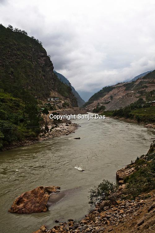 The Punatsangchu river flows towards the Punatsangchu Hydro Power Project site in Punakha, Bhutan. Photo: Sanjit Das/Panos