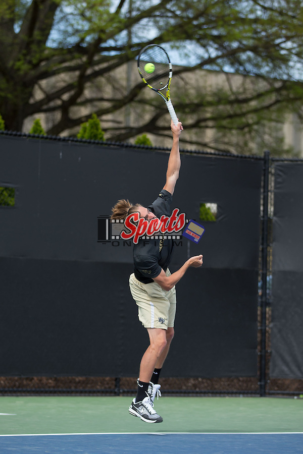Romain Bogaerts of the Wake Forest Demon Deacons serves the ball against the North Carolina Tar Heels at the Wake Forest Tennis Center on April 11, 2015 in Winston-Salem, North Carolina.  The Demon Deacons defeated the Tar Heels 4-3.    (Brian Westerholt/Sports On Film)