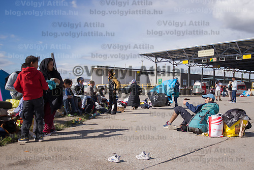 Illegal migrant family traveling to Germany wait at an aid distribution point at Hegyeshalom border crossing (about 180 km West of capital city Budapest), Hungary on September 06, 2015. ATTILA VOLGYI