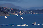 Fog over Boats sailing on San Francisco Bay on a clear blue sky day, Marin County, California