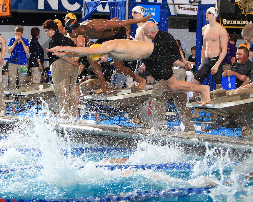 The University of Michigan men's swimming and diving team finished day one in first place (153 points) at the NCAA Championships at IU Natatorium Indianapolis, Ind., on March 28, 2013.