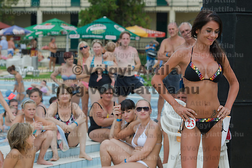 Viewers watch participant Alexandra Varga attend the Miss Bikini Hungary beauty contest held in Budapest, Hungary on August 06, 2011. ATTILA VOLGYI