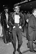 Manhattan, New York City, NY - March 8, 1971  Muhammad Ali and Joe Frazier at Madison Square Garden  - Billed as the 'Fight of the Century' African-American boxing fans and dandies attended wearing the most glam-fashions of the day. Furs, minis and thigh-high platform boots were all the rage.