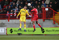 Fleetwood Town's Ched Evans and Crawley Town's Lewis Young<br /> <br /> Photographer Rob Newell/CameraSport<br /> <br /> Emirates FA Cup Second Round - Crawley Town v Fleetwood Town - Sunday 1st December 2019 - Broadfield Stadium - Crawley<br />  <br /> World Copyright © 2019 CameraSport. All rights reserved. 43 Linden Ave. Countesthorpe. Leicester. England. LE8 5PG - Tel: +44 (0) 116 277 4147 - admin@camerasport.com - www.camerasport.com