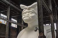 """A Subtlety"" or ""The Marvelous Sugar Baby"" by the artist Kara Walker is displayed in the former Domino Sugar Factory in Williamsburg, Brooklyn in New York seen on Saturday, May 24, 2014. A giant sphinx-like figure, 75 feet long made of 160,000 pounds of sugar on a polystyrene core is the centerpiece of the exhibit which is located in the sugar factory that has been closed for a decade and is scheduled to be torn down to make way for development. Walker also created a series of ""Candy Boys"" sugar sculptures which dot the rest of the warehouse.The exhibit is part of Creative Time and will run until July 6. (© Richard B. Levine)"