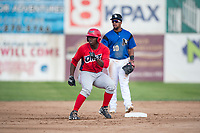 Orem Owlz left fielder Johan Sala (25) rounds second base as second baseman Eddie Hernandez (10) looks on during a Pioneer League game against the Missoula Osprey at Ogren Park Allegiance Field on August 19, 2018 in Missoula, Montana. The Missoula Osprey defeated the Orem Owlz by a score of 8-0. (Zachary Lucy/Four Seam Images)