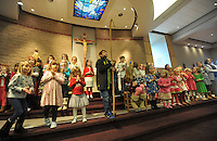 NWA Media/Michael Woods --12/23/2014-- w @NWAMICHAELW...Kids from  St. Joseph Catholic Church in Fayetteville get to their spots on stage during their rehearsal Tuesday morning for the churches Christmas Eve Pageant.