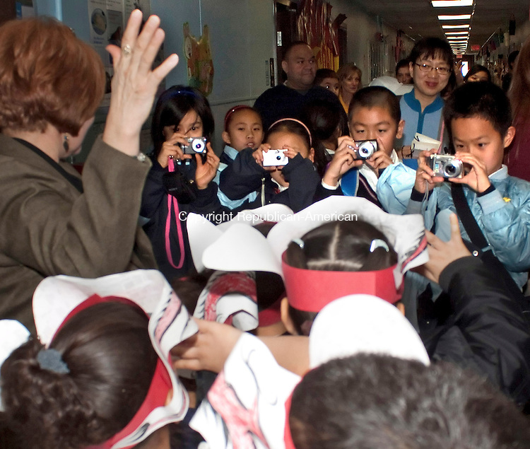 WATERBURY CT-11 JANUARY 2011 011112DA01-  Students of Qingdao Experimental Primary School in China take photos of Amelia Gonzalez and her first grade students during their visit to Carrington Elementary School in Waterbury on Wednesday.Darlene Douty Republican American..