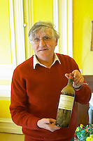 Bernard Jany. Bottle of Chateau de la Condamine from the time of Mademoiselle Bertrand. Chateau la Condamine Bertrand. Pezenas region. Languedoc. Owner winemaker. France. Europe. Bottle.