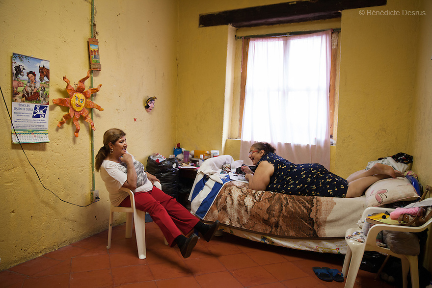 Gloria and Maria isabel, both residents of Casa Xochiquetzal, at the shelter in Mexico City, Mexico on July 4, 2013. Casa Xochiquetzal is a shelter for elderly sex workers in Mexico City. It gives the women refuge, food, health services, a space to learn about their human rights and courses to help them rediscover their self-confidence and deal with traumatic aspects of their lives. Casa Xochiquetzal provides a space to age with dignity for a group of vulnerable women who are often invisible to society at large. It is the only such shelter existing in Latin America. Photo by Bénédicte Desrus