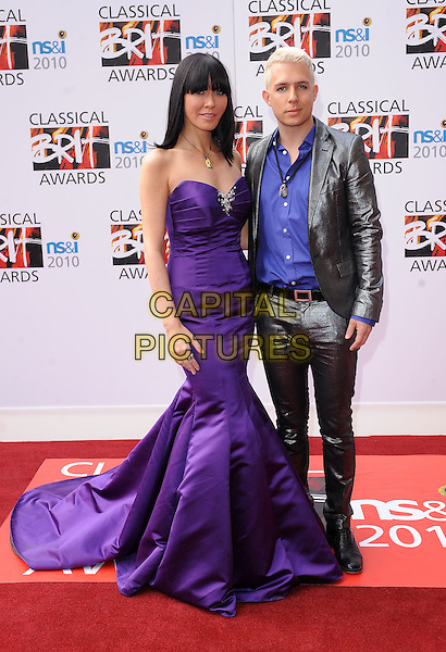 LINZI STOPPARD & BEN LEE of FUSE.Attending The Classical BRIT Awards, Royal Albert Hall, London, England, UK,.13th May 2010.Brits arrivals full length long maxi fishtail gown dress strapless purple silver grey gray shiny suit blue shirt .CAP/BEL.©Tom Belcher/Capital Pictures.